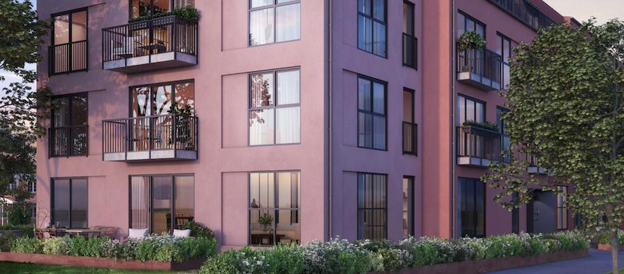 En rosa byggnad i modern stil.