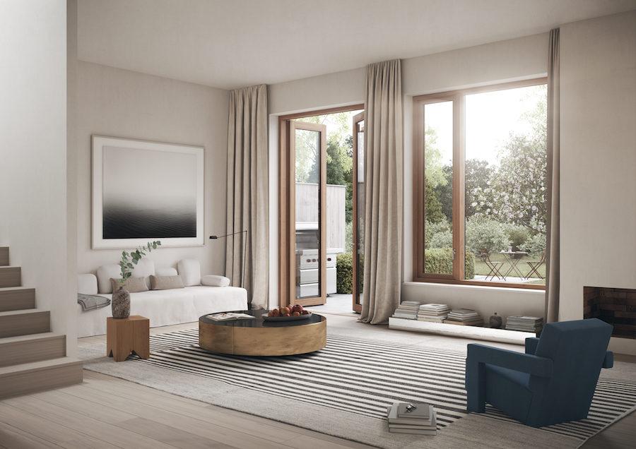 Vardagsrummet med stora fönster och rikt ljusinsläpp.