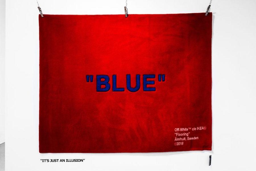 """Bild på röd matta med ordet """"blue"""" från Ikea:s Markerad-kollektion tillsammans med Virgil Abloh."""